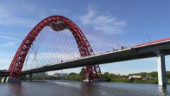 The modern urban car cable-stayed bridge over the river Stock Footage