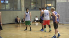 Men's Rec League basketball game player shooting free throws Stock Footage