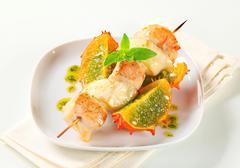 Chicken and aubergine skewer with pesto sauce and Kawani fruit - stock photo