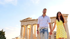 Beautiful Greek Couple walking and observing historical Greek architecture. Stock Footage