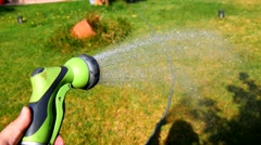Watering garden with hose (4K) Stock Footage