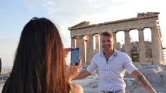 Handsome Greek man poses for a photo in front of a Greek temple. Stock Footage