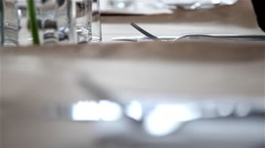 Fork and knife on a table - stock footage