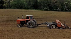 Tractor with attached seeding equipment planting soybean seeds Stock Footage