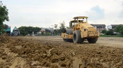 Road roller steamroller or vibratory roller on construction site - stock footage