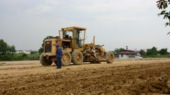 Motor grade Machine and people working at construction site Stock Footage