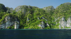 Lime Stone Rocks at the Coast Line of Phi Phi Leh Stock Footage