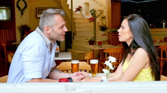 Greek couple talking on a date at a cafe in Greece. - stock footage