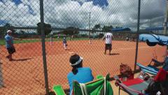 Woman watching a kid's baseball game Stock Footage