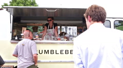 Gathering of gourmet food trucks and carts Stock Footage
