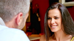 Beautiful Greek woman talking on a date at a cafe in Greece. - stock footage