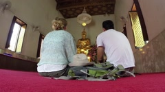 Tourists visit Buddhist Temple.Thailand - stock footage