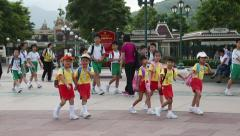 Сhildren and educators at the exit of the park Disneyland, Hong Kong Stock Footage