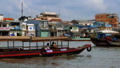 Mekong Delta - May 2015: Boats on river at floating market. 4K speed up. Stock Footage