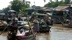 Mekong Delta - May 2015: Floating market with vendors on boats. 4K resolution. Stock Footage