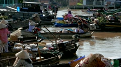 Mekong Delta - May 2015: Floating market with vendors on boats. 4K speed up. - stock footage