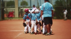 Kid's baseball team celebrating with coaches Stock Footage