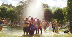 Taking photo in fountain at gay parade Stock Footage