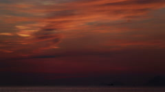 view of dawn clouds above sea island and boat - stock footage