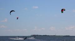 Kiteboarding in Tampa Bay off St Petersburg Florida Skyway Bridge Stock Footage