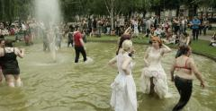 People having fun at gay parade in water fountain Stock Footage