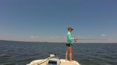 Young woman flats fishing in Gulf of Mexico off the coast of Steinhatchee Flo Stock Footage