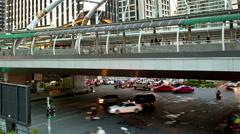 Sathorn bridge, Bangkok traffic intersection tilt time-lapse Stock Footage