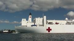 Hospital Ship USNS Mercy with tug boat Stock Footage