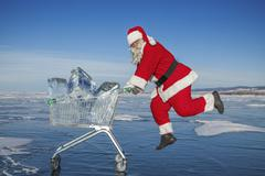 Santa Claus with a trolley of pure ice at winter Baikal lake - stock photo