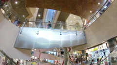 POV shot of an escalator going down in Langham Place mall Stock Footage