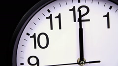 Wall clock on a black 00,00 close-up Stock Footage