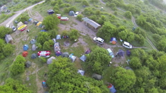 Tourist camp with tents from height. Aerial view Stock Footage
