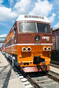 braun orange train at station - stock photo