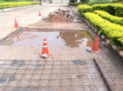 Pothole and road surface repairing works Stock Photos