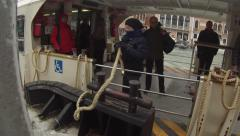 Stock Video Footage of Venice. Boat by public transport (vaporetto) arrives at the stop (pier)