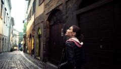 Woman walk and look around in ancient city street in Bergamo, Italy HD Stock Footage