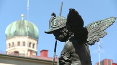 Marienplatz, Munich: Angel killing the snake Stock Footage