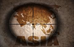 sniper scope aimed at the vintage asia map - stock illustration