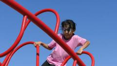 Asian Girl With Face Paint Having Fun On Climbing Structure - stock footage