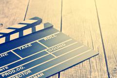 Movie clapper. Vintage photo shot. Stock Photos