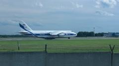 Antonov An-124-100 Ruslan (RA-82045) backtracking runway 25 for take off Stock Footage