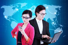 Two workers and global communication network - stock photo