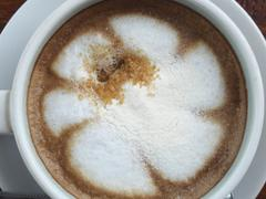 Stock Photo of Hot latte coffee in white cup. View from above.
