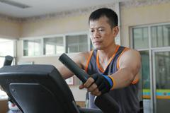 Exercising in the gym,Man walking on treadmill. Stock Photos