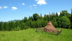 Amazing panorama of beautiful mountain landscape with haymow at green meadow Stock Footage