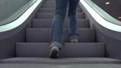 Person on Escalators in Modern Urban Interior - stock footage