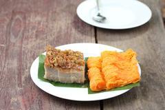 Stock Photo of Thai dessert, coconut custard squares and golden threads.