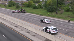 Fatal car accident scene on highway car cut in half and police investigating - stock footage