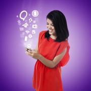 Young woman using mobile app - stock photo