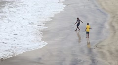African boys walking on beach Stock Footage